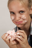Girl eating dessert Royalty Free Stock Image