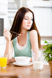 Girl eating dieting muesli and orange juice Stock Image
