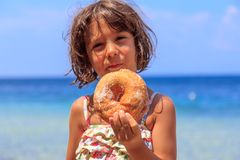 Girl eating donut Royalty Free Stock Image