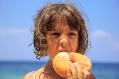 Girl eating donut Royalty Free Stock Images
