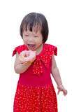 Girl eating donut over white Royalty Free Stock Photography