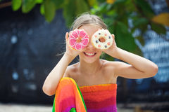 Girl eating donuts Stock Image