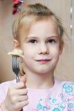 Girl eating dumplings Royalty Free Stock Photography