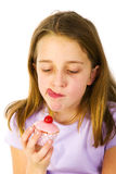 Girl is eating fancy cakes Royalty Free Stock Image
