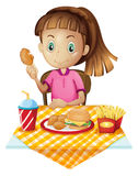 A girl eating at the fastfood store Stock Photos