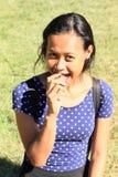 Girl eating fig stock photo