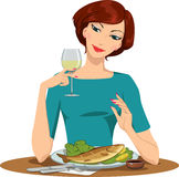 Girl eating fish and drinking wine Royalty Free Stock Image