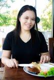 Girl eating Fish salmon steak Royalty Free Stock Image