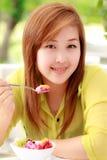 Girl eating food Royalty Free Stock Photo