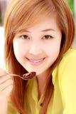 Girl eating food Royalty Free Stock Photos