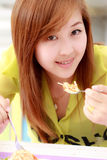 Girl eating food Stock Photography