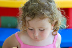 Girl eating food. Portrait of cute young girl with mouth full of food Stock Image