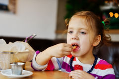 Girl eating french fries Stock Image