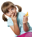 Girl eating french fries Stock Photo