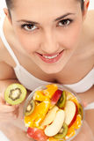 Girl eating fresh fruit salad Royalty Free Stock Photography