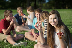 Girl Eating with Friends Stock Photos
