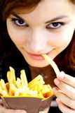 Girl eating fries stock images