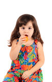 Girl eating fruit Royalty Free Stock Photo