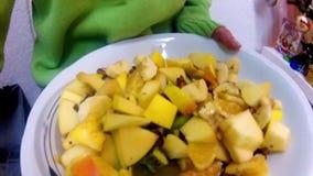 Girl eating fruit salat dessert stock video