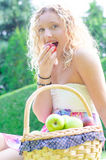 Girl eating fruit Royalty Free Stock Photography