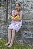 Girl is eating fruits. 7 year old girl is eating fruits Royalty Free Stock Photography