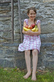 Girl is eating fruits. 7 year old girl is eating fruits Stock Photography