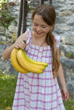 Girl is eating fruits Stock Photo