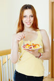 Girl eating fruits salad Stock Photo