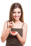 Girl eating goji Royalty Free Stock Images