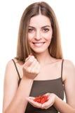 Girl eating goji Royalty Free Stock Image