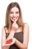 Girl eating goji Stock Photo