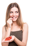 Girl eating goji Royalty Free Stock Photography