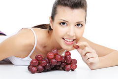 Girl eating grape Royalty Free Stock Photos
