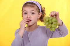 Free Girl Eating Grapes. Royalty Free Stock Photos - 26960128