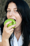 Girl eating green apple Stock Photo
