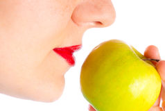 Girl eating green apple close up 4 Stock Photography