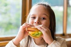 Girl eating hamburger Royalty Free Stock Photo