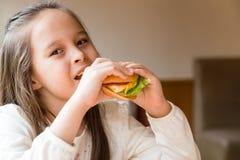 Girl eating hamburger Stock Photo