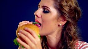 Girl eating hamburger. stock footage