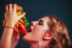 Girl eating hamburger. Royalty Free Stock Image
