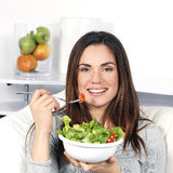 Girl eating healthy food Stock Photography
