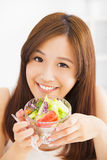 Girl eating healthy food salad Stock Photos