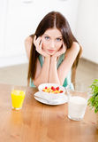 Girl eating healthy muesli and strawberry Royalty Free Stock Image