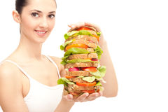 Girl eating healthy sandwich Royalty Free Stock Photography