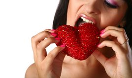 Girl is eating heart royalty free stock images