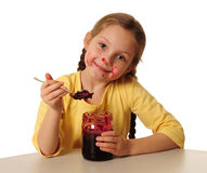 Girl eating homemade jam Stock Photos