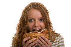 Girl eating hot dog Stock Image