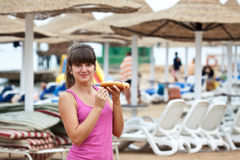 Girl eating hot dog Stock Photography