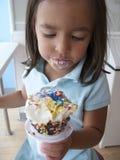 Girl eating ice cream Stock Image