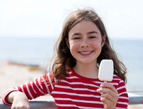 Girl eating ice-cream Stock Image